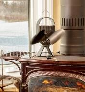 Large Ecofan AirDeco on a wood stove, distributing the heat of the fire