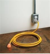 15' Heavy-Duty 12-Gauge Extension Cord plugged into an outlet