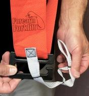 A close view of the adjustable tether used to secure a load to the Bucket Buddy Sash