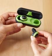 ISOtunes Free wireless electronic hearing protectors placed in the hard-shell case for recharging