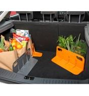 Three brackets supporting grocery bags and plants in a vehicle's cargo area