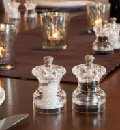Cole & Mason Mini Salt & Pepper Mills on a dining table with candles behind