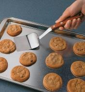 Stainless-Steel Spatula sliding under a cookie on a baking sheet