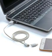 2-in-1 USB Charging Cable connected to a laptop