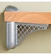Colonial Tumbled Nickel Adjustable Bracket mounted on a wall with a wooden shelf