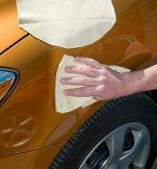 Cleaning a car with chamois