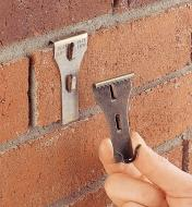 Brick Clip attached to a brick wall