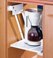 A swing-up shelf made with the Appliance Lift in the stored position, holding a coffeemaker