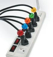 A power bar with five cords plugged in, each with a different-colored cord identifier attached