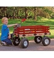 A boy places balls in the All-Season Convertible Wagon with wheels on
