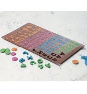 Chocolate Mold filled with various colors of chocolate, with some chocolate letters removed