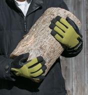 Holding a log while wearing Cold-Weather Gloves