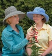 Two women wearing Classic Sun Hats outdoors
