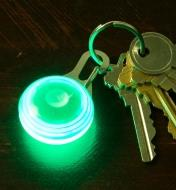 Green Carabiner Light attached to a set of keys