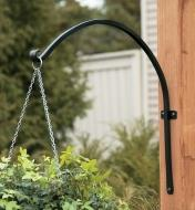 Arched Plant Hanger holding a hanging basket on an outdoor post