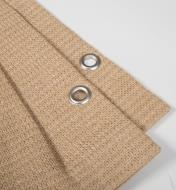 Close-up of grommets in pleats of accordion shade canopy