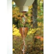 Water from a downspout opening cascades through the fluted funnels on the copper rain chain