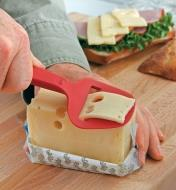 Using a Cheese Plane to cut a slice from a block of Swiss cheese
