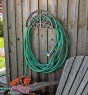Classic Hose Hanger mounted on a wall, with a hose looped around it