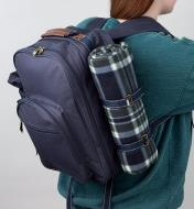 A woman carrying the Deluxe Picnic Backpack on her back