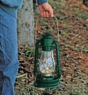 Dietz No. 80 Hurricane Lantern carried by the handle