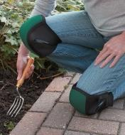 A woman wearing Contoured Knee Pads while gardening