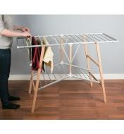 Folding Floor Clothes Dryer unfolded with towels and clothes hanging on the bars