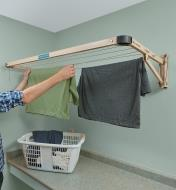 Hanging clothes on the Folding Drying Rack