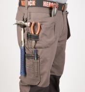 Side of Gray Heavyweight Pants with tools in pockets and loops