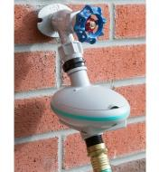 Dial-Operated Water Timer connected to a faucet and hose