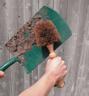 Cleaning a spade with the Heavy-Duty Brush