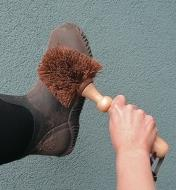 Cleaning a boot with the Heavy-Duty Brush