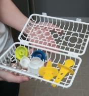 An open Dishwasher Basket holding a variety of small items