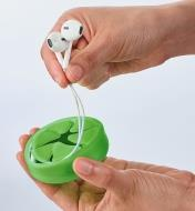Pulling earbuds out of the earbud storage case