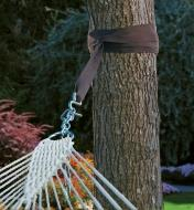 Hammock Tree Strap wrapped around a tree trunk, its hook attached to the end of a hammock