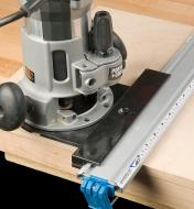 Low-profile tool guide in use with a router plate and router
