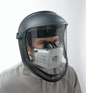 Low-profile respirator fits under face shield (not included).