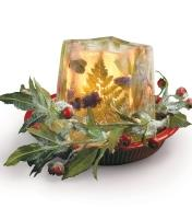 Ice Lantern used as a centerpiece with flowers and greenery frozen inside
