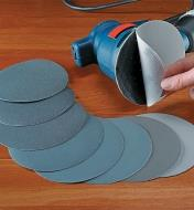 Set of 8 Micro-Mesh Discs spread out beside an electric sander
