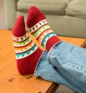 A person's feet clad in Lee Valley Woodworker's Socks propped on a coffee table