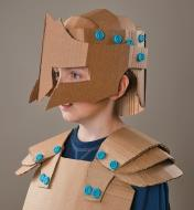 Child wearing a suit of armor made using the Makedo Cardboard-Building System