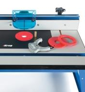Kreg Precision Insert Plate inserted in a bench-top router table