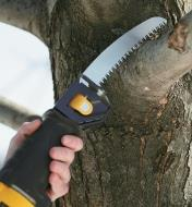 Pruning blade installed in a reciprocating saw being used to cut a tree branch