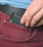 Slipping the Pocket Survival Tool into a pants pocket