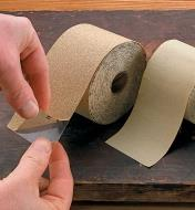Peeling the backing off a PSA Sandpaper Roll