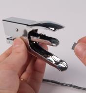 Inserting a staple strip in the rail inside the stapler
