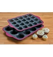 Stacked regular and mini Muffin Pans beside four frosted cupcakes
