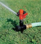 Impulse Sprinkler Head & Spike Base in operation on a lawn