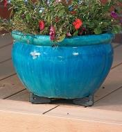 Black Pot Toes holding a planter on a deck