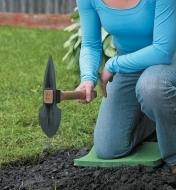 Using a Mini Planter to dig in garden soil